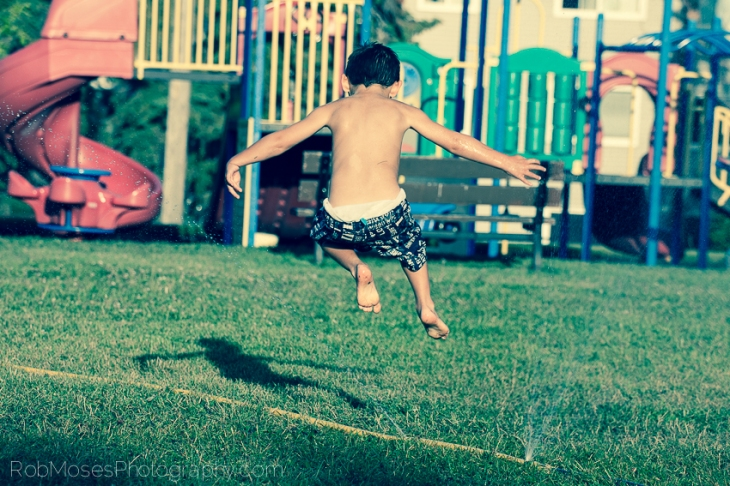 Boy Playing Spinkler Summer Child jumping - Rob Moses Photography 3