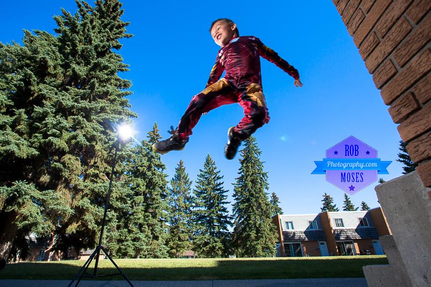 Boy kid jumping ironman costume off camera flash canon - Rob Moses Photography
