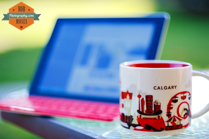 Calgary famous Starbucks coffee cup mug ipad keyboard bokeh dof shallow city skyline saddledome - Rob Moses Photography - Canadian American Photographer