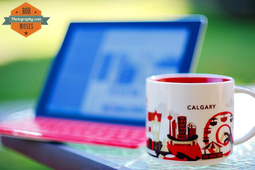 Calgary famous Starbucks coffee cup mug ipad keyboard bokeh dof shallow city skyline saddledome - Rob Moses Photography - Canadian American Photographer