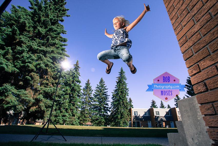 girl kid jumping off camera flash canon - Rob Moses Photography
