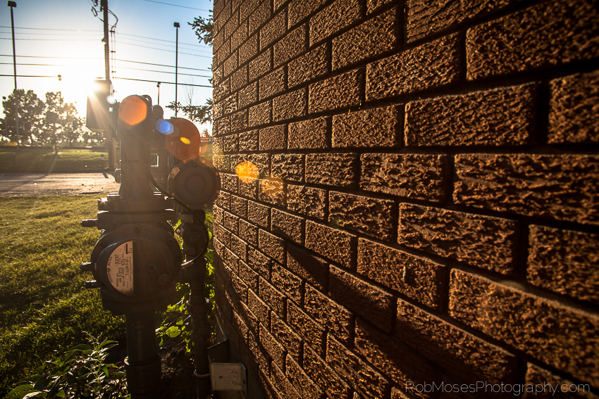 random sunset golden hour brick wall pipes sky famous light flare - Rob Moses Photography