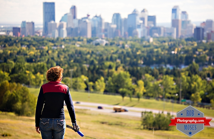 Woman walking dog famous nose hill park Calgary alberta Canada yyc skyline city urban - Rob Moses Photography - Photogapher