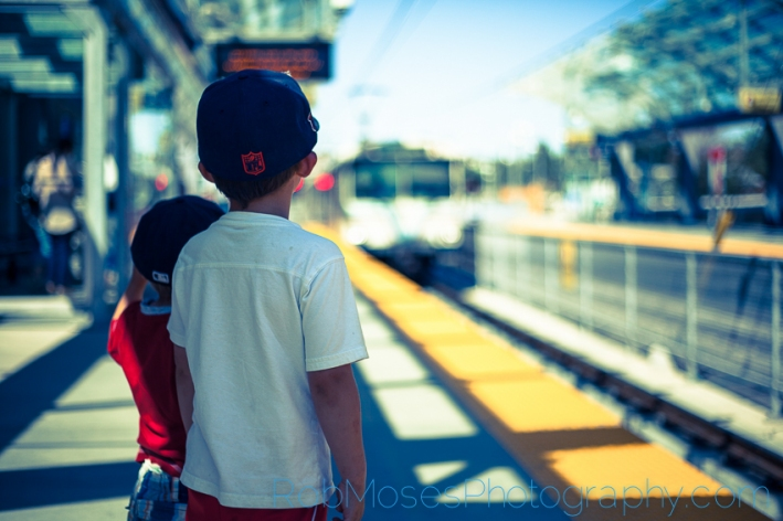 1 Boys waiting for train bokeh - City kid kids yyc urban children city life - Rob Moses Photography