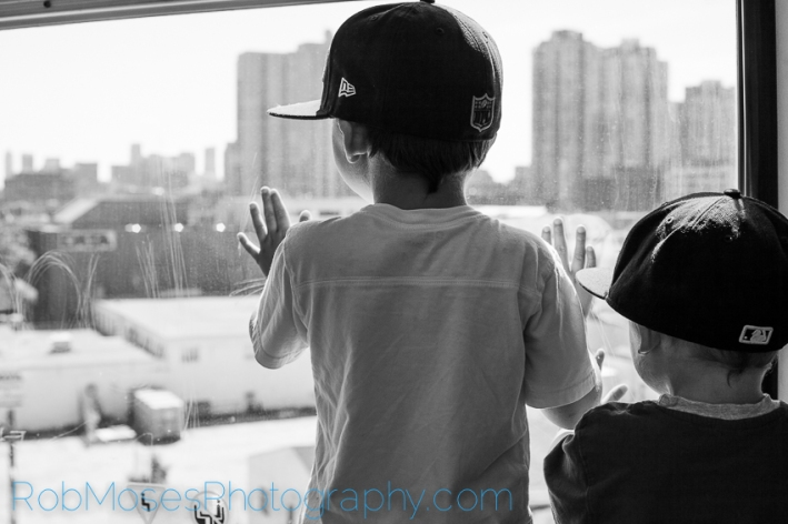 3 boys on train subway - City kid kids yyc urban children city life - Rob Moses Photography