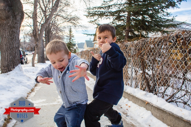 Children boys kids fun Calgary Winter Bridgeland yyc excited fun jumping running yahoo - Rob Moses Photography - Family-1