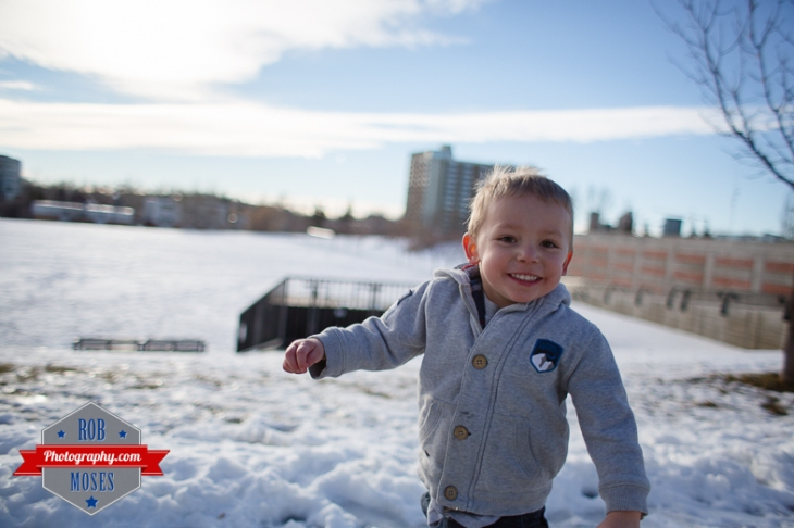 Children boys kids fun Calgary Winter Bridgeland yyc excited fun jumping running yahoo - Rob Moses Photography - Family-10