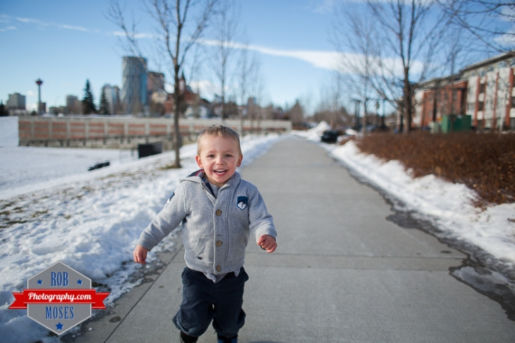 Children boys kids fun Calgary Winter Bridgeland yyc excited fun jumping running yahoo - Rob Moses Photography - Family-11