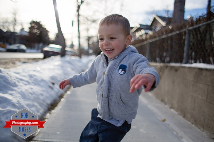 Children boys kids fun Calgary Winter Bridgeland yyc excited fun jumping running yahoo - Rob Moses Photography - Family-4