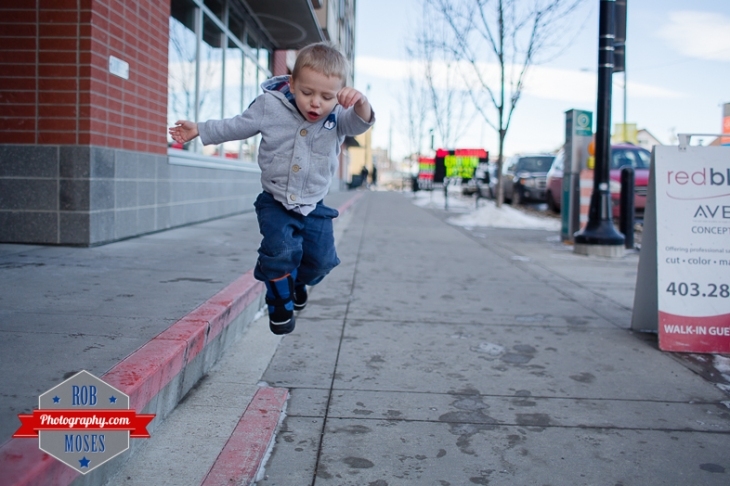 Children boys kids fun Calgary Winter Bridgeland yyc excited fun jumping running yahoo - Rob Moses Photography - Family-7