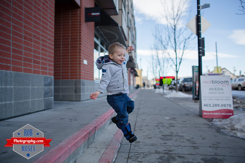 Children boys kids fun Calgary Winter Bridgeland yyc excited fun jumping running yahoo - Rob Moses Photography - Family-9