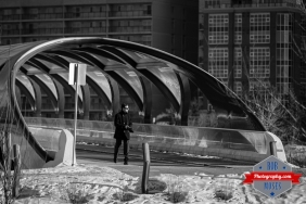 Calgary alberta canada man walking winter shades urban city famous peace bridge buildings yyc street photographer - Rob Moses Photography - Vancouver Seattle Photographers best top.jpg