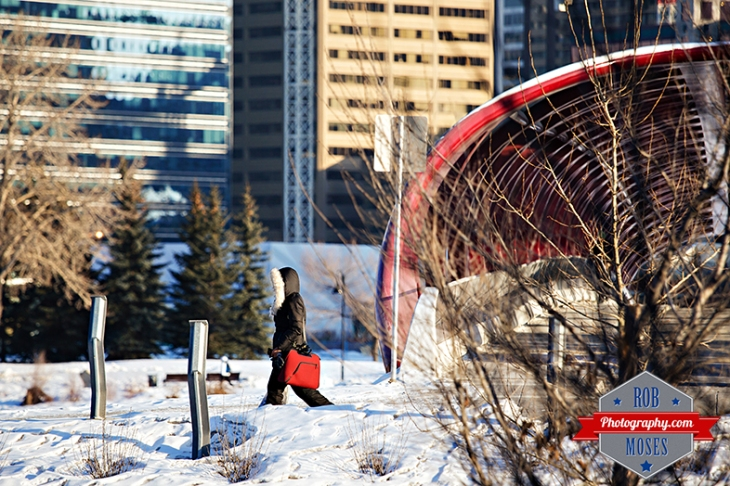 Calgary alberta canada woman walking winter fur jacket red bag urban city famous peace bridge buildings yyc street photographer - Rob Moses Photography - Vancouver Seattle Photographers best top