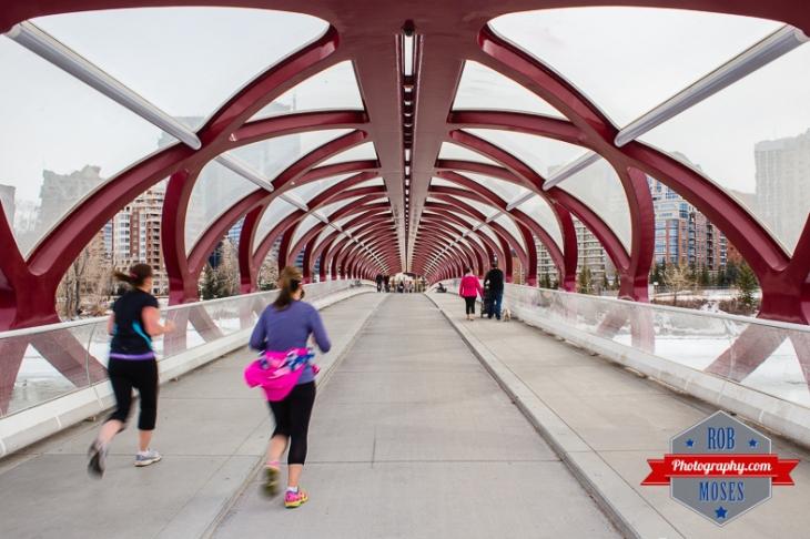 Calgary Famous Peace Bridge running runners jog jogging woman girls tunnle modern - Rob Moses Photography - Vancouver Seattle Photographer Photographers-1
