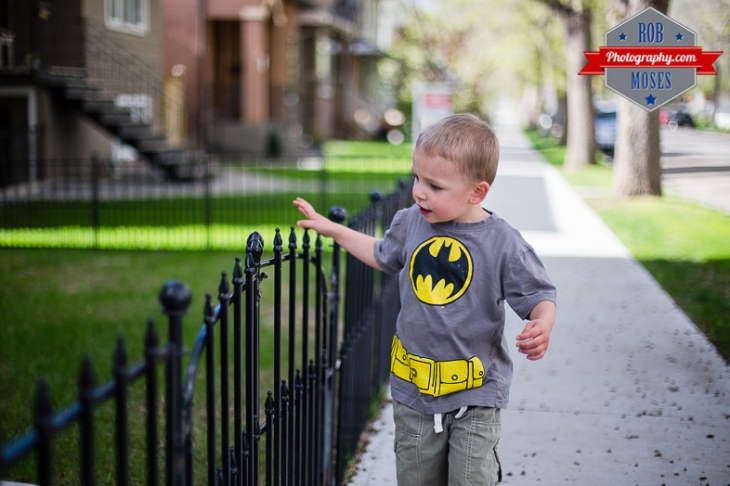 Boy child kid Batman street bokeh walk fence - Rob Moses Photography - Seattle Vancouver Calgary Photographer Native American Photographers top famous best popular