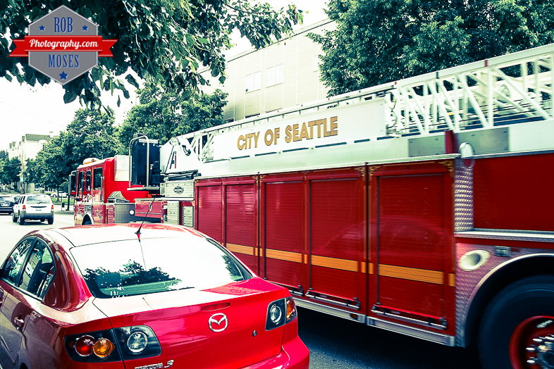 Seattle Fire truck mazda car street Washington State WA USA - Rob Moses Photography - Seattle Vancouver Calgary Photographer Native American Photographers