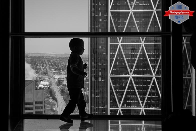 Child Boy Son silhouette building Skyscraper bow Calgary tower yyc - Rob Moses Photography - Native American Alaskan Famous Tlingit - Seattle Top Vancouver Photographer Popular Photographers