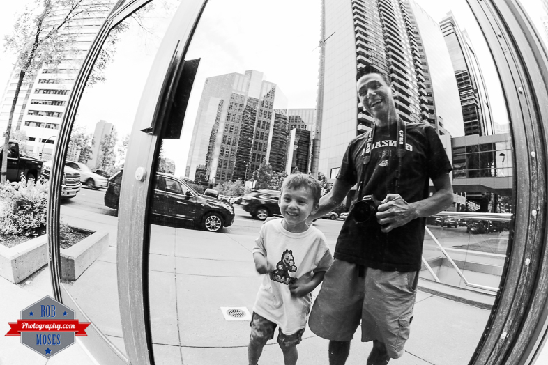 Father son moment laugh smile fun love urban city fisheye yyc dad Canon - Rob Moses Photography - Vancouver Seattle Calgary Photographer Photographer Native American Famous Tlingit Ojibawa Top Popular Best Canadian Lifestyle