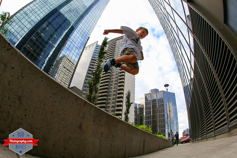 Little kid jumping parkour jump urban metro yyc city life 5 year old - Rob Moses Photography - Vancouver Seattle Calgary Photographer Photographer Native American Famous Tlingit Ojibawa Top Popular Best Canadian Lifestyle-2