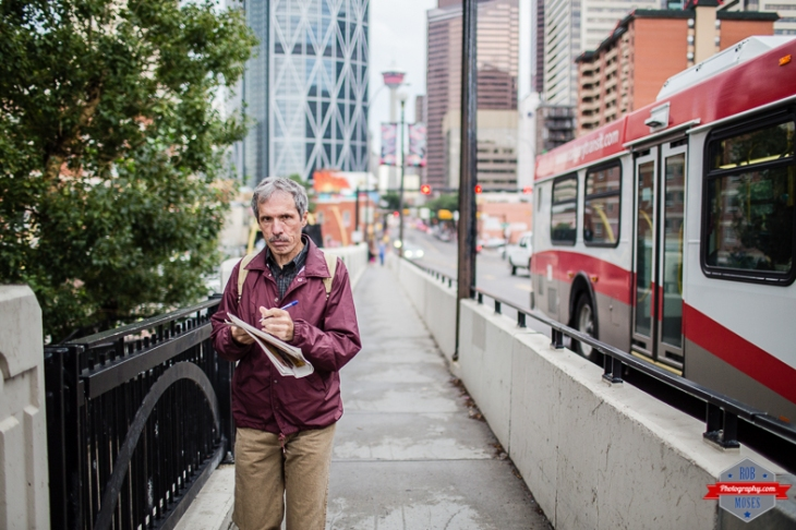 Crossword walking man yyc street Centre Bridge urban metro city life 35L bokeh - Rob Moses Photography - Vancouver Seattle Calgary Photographer Photographer Native American Famous Tlingit Ojibawa Top Popular Best Canadian Lifestyle