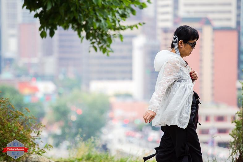 Woman Girl walking YYC urban city bokeh street - Rob Moses Photography - Vancouver Seattle Calgary Photographer Photographer Native American Famous Tlingit Ojibawa Top Popular Best Canadian Lifestyle-5