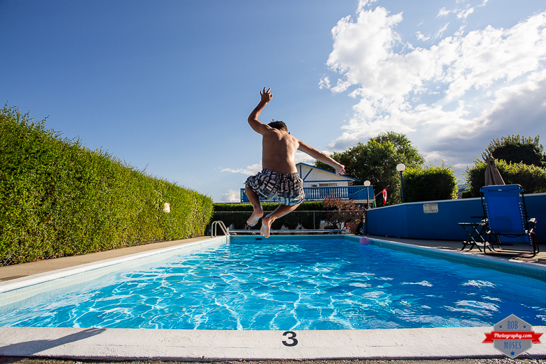 1 Boy Child Kid Son Joshua Jumping Pool Penticton BC British Columba Fun jump - Rob Moses Photography - Vancouver Seattle Calgary Photographer Photographer Native American Famous Tlingit Ojibawa Top Popular Best Canadian Lifestyle