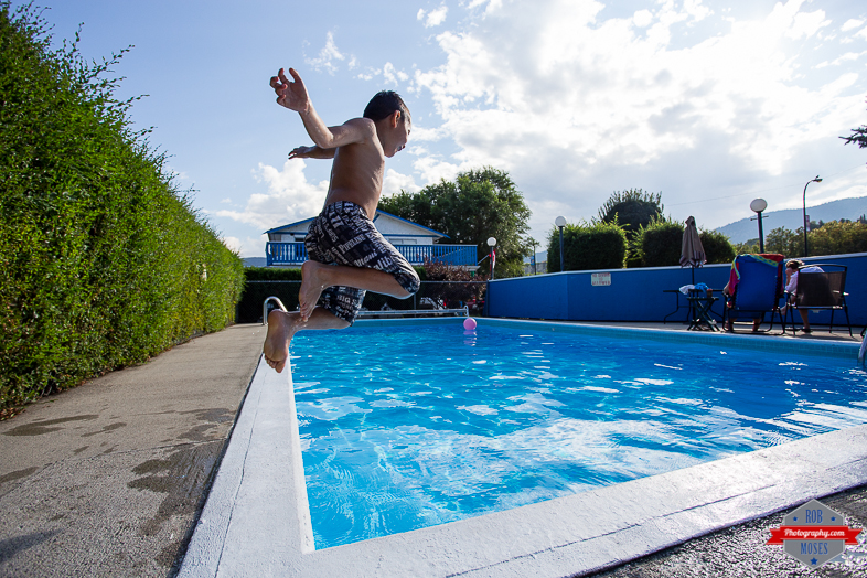3 Boy Child Kid Son Joshua Jumping Pool Penticton BC British Columba Fun jump - Rob Moses Photography - Vancouver Seattle Calgary Photographer Photographer Native American Famous Tlingit Ojibawa Top Popular Best Canadian Lifestyle
