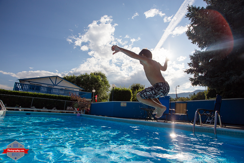 4 Boy Child Kid Son Joshua Jumping Pool Penticton BC British Columba Fun jump - Rob Moses Photography - Vancouver Seattle Calgary Photographer Photographer Native American Famous Tlingit Ojibawa Top Popular Best Canadian Lifestyle