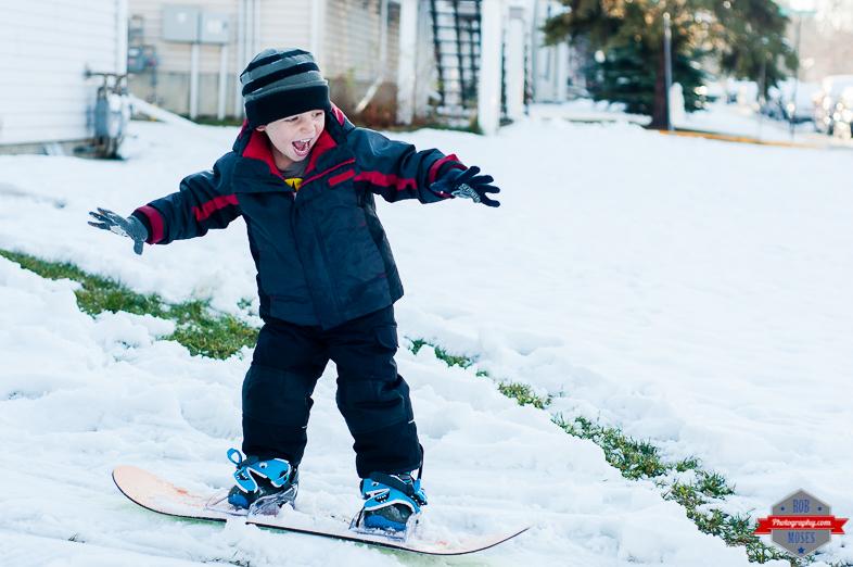 Kid boy child Burton snowboarding snowboard yyc - fun family winter snow - Rob Moses Photography -Calgary Photographer Photographers Native American Famous Tlingit Ojibawa Top Popular Best Good Canadian Awesome Lifestyle-6