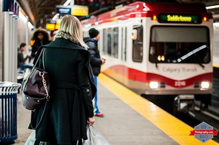 2 YYC Subway C-Train LRT Woman girl iphone texting train station Rob Moses Photography Calgary Photographer Photographers Native American Famous un celebrity Tlingit Ojibawa Top Popular Best Good Canadian