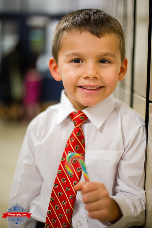 7 Child kid Christmas concert Flames tie cute - Rob Moses Photography - Calgary Photographer Photographers Native American Famous un celebrity Tlingit Ojibawa Top Popular Best Good Canadian