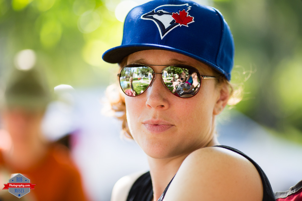Neighbor woman girl Toronto Blue Jays baseball hat bokeh shades reflection - Rob Moses Photography Calgary Photographer Photographers Native American Famous un celebrity Tlingit Ojibawa Top Popular Best Good Canadian