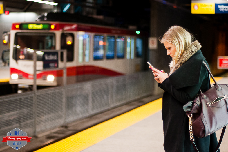 YYC Subway C-Train LRT Woman girl iphone texting train station Rob Moses Photography Calgary Photographer Photographers Native American Famous un celebrity Tlingit Ojibawa Top Popular Best Good Canadian