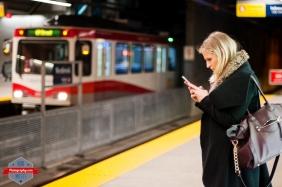 YYC Subway C-Train LRT Woman girl iphone texting train station Rob Moses Photography Calgary Photographer Photographers Native American Famous un celebrity Tlingit Ojibawa Top Popular Best Good Canadian