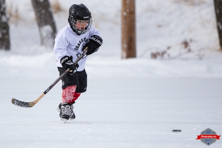 8 Boy child kid grassroots hockey outdoor action sports Rob Moses Photography Calgary Photographer Photographers Native American Famous un celebrity Tlingit Ojibawa Top Popular Best Good Canadian YYC