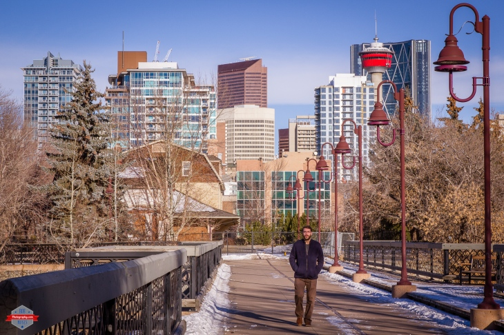 YYC bridge city buildings winter sky street man walking tower sunny Rob Moses Photography Calgary Vancouver Seattle Spokane Photographer WA BC Native American Tlingit Ojibaway famous un celebrity Canadian best