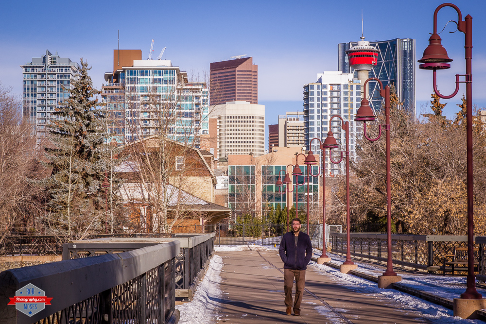 YYC bridge city buildings winter sky street man walking tower sunny Rob Moses Photography Calgary Vancouver Seattle Spokane Photographer WA BC Native American Tlingit Ojibaway famous un celebrity Canadian best-