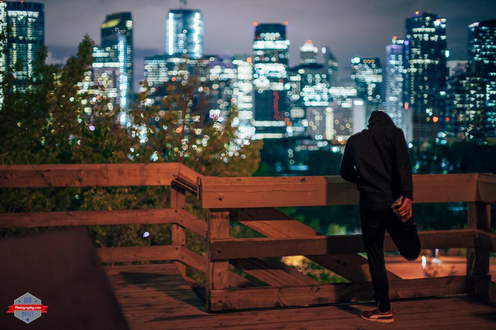 Night runner stretching calgary city skyline urban bokeh a7ii canon fd 50mm 1.2 Rob Moses Photography Portland Calgary Vancouver Seattle Spokane Photographer WA BC Native American Tlingit Ojibaway famous un celebrity Canadian best pdx-9