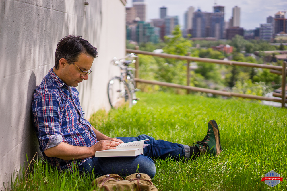 Man reading grass urban city relaxing yyc Rob Moses Photography Portland Calgary Vancouver Seattle Spokane Photographer WA BC Native American Tlingit Ojibaway famous un celebrity Canadian best pdx