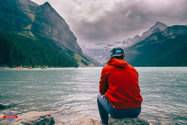 lake-louise-alberta-man-mountains-view-rob-moses-photography-portland-calgary-vancouver-seattle-spokane-photographer-wa-bc-native-american-tlingit-ojibaway-famous-un-celebrity-canadian-best-pdx